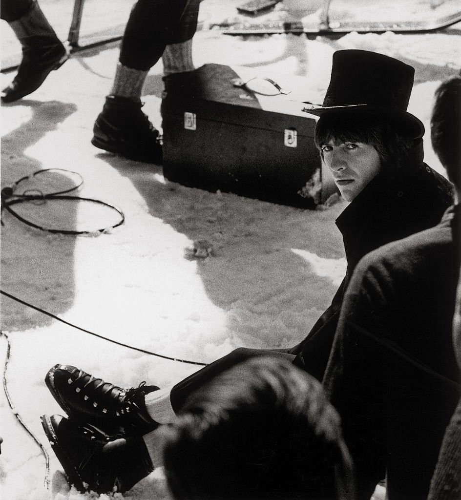 """George Harrison (The Beatles) during the shooting of the film """"Help!"""" on Obertauern.  