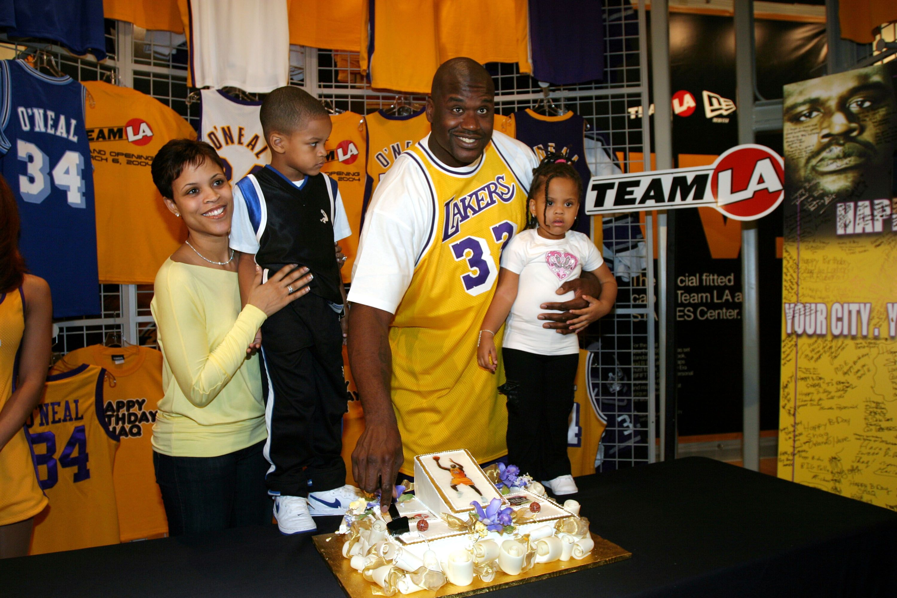 Shaquille O'Neal with ex-wife Shaunie and his children Shareef and Amirah at the opening of Team LA Store in 2004 in Los Angeles, California | Source: Getty Images