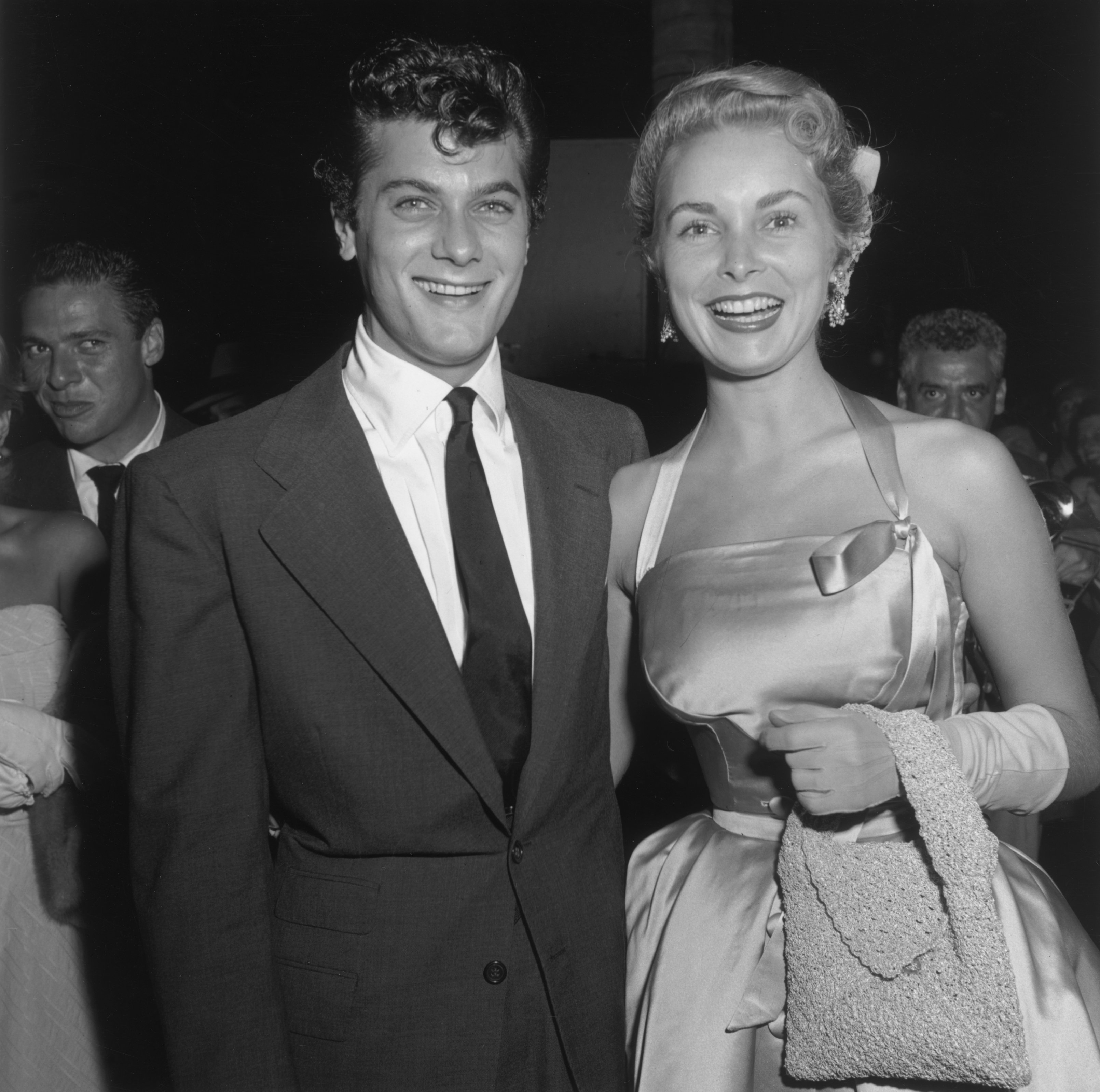 Tony Curtis and Janet Leigh smile as they attend the premiere of director Elia Kazan's 1951 film, 'A Streetcar Named Desire,' Hollywood, California | Photo: Getty Images