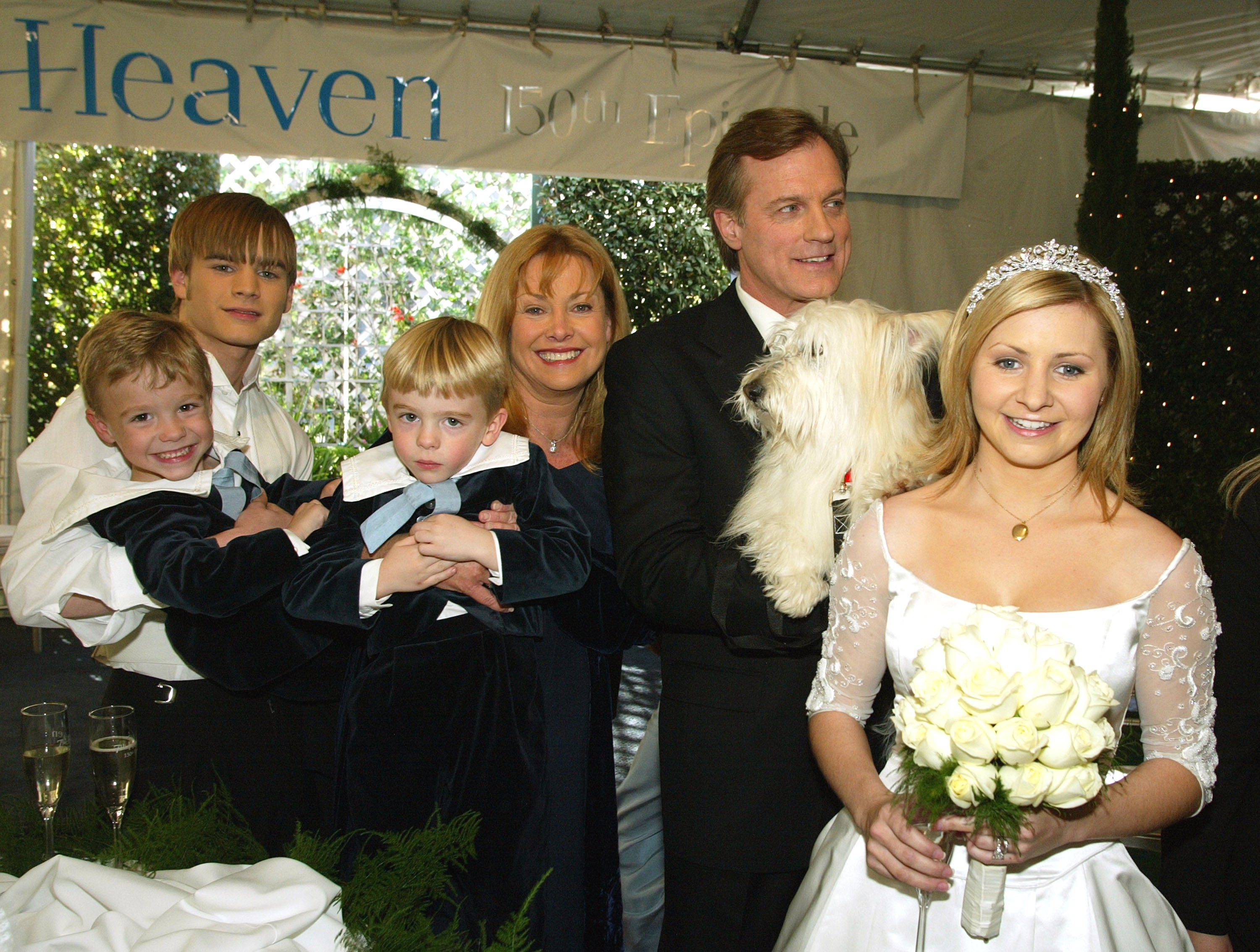 """David Gallagher, twins Lorenzo and Nikolas Brino, Catherine Hicks, Stephen Collins, and Beverley Mitchell pose at a reception to celebrate 150 episodes of """"7th Heaven"""" on February 20, 2003 in Los Angeles, California 