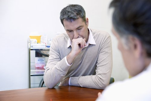 A worried man talking to a doctor. | Source: Shutterstock.