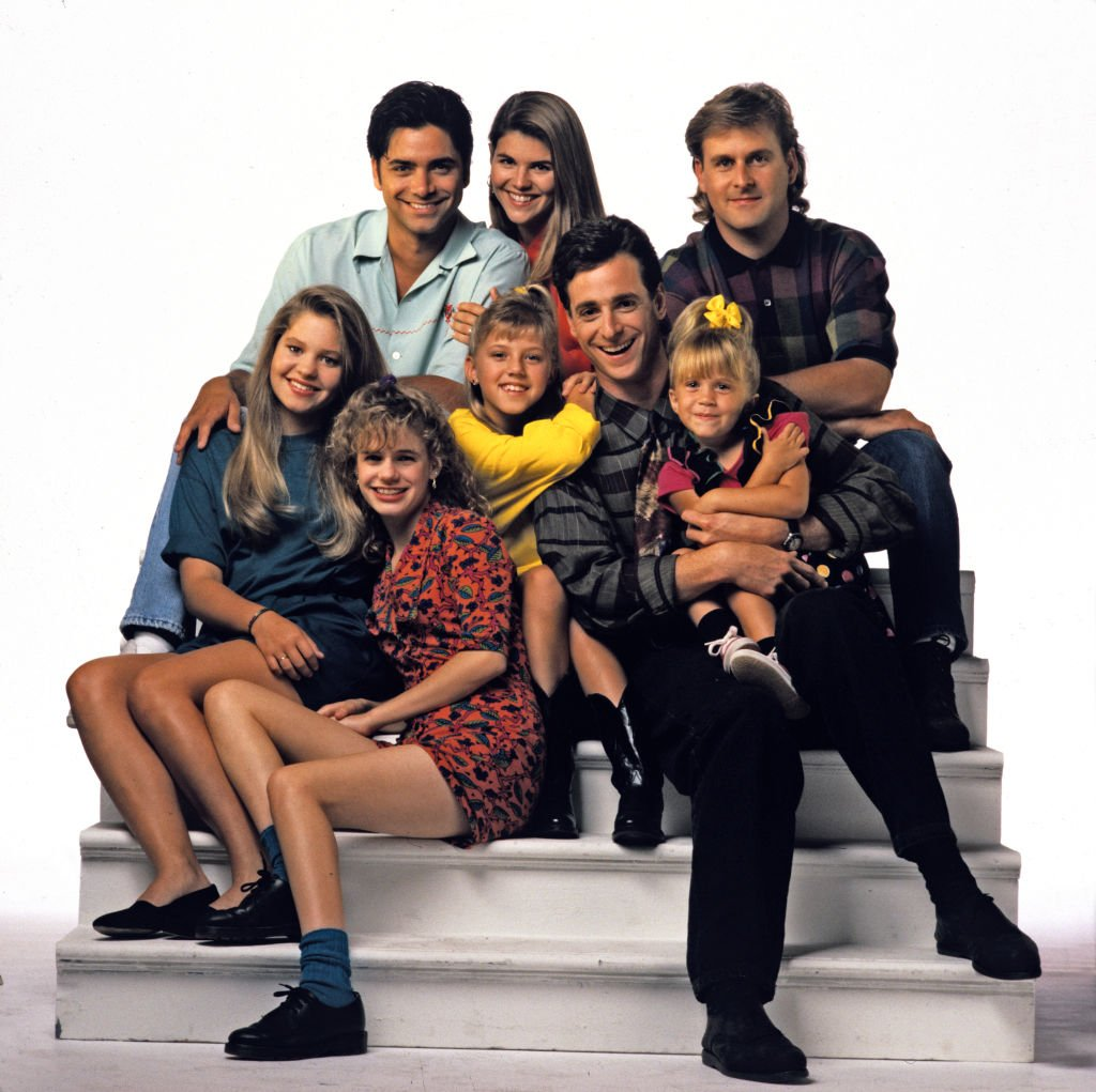 John Stamos, Lori Loughlin, Dave Coulier; Candace Cameron, Andrea Barber, Jodie Sweetin, Bob Saget, Mary-Kate Olsen / Ashley Olsen Season Five promotional photo for the ABC tv series 'Full House', September 3, 1991 | Photo: Getty Images