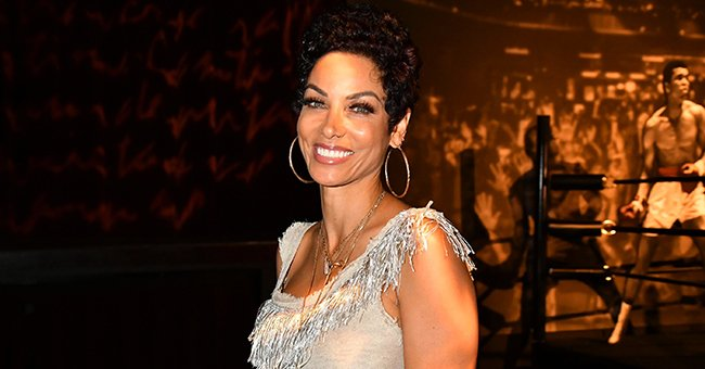 Nicole Murphy Can't Stop Flaunting Her Enviable Figure as She Works Out in a White Top