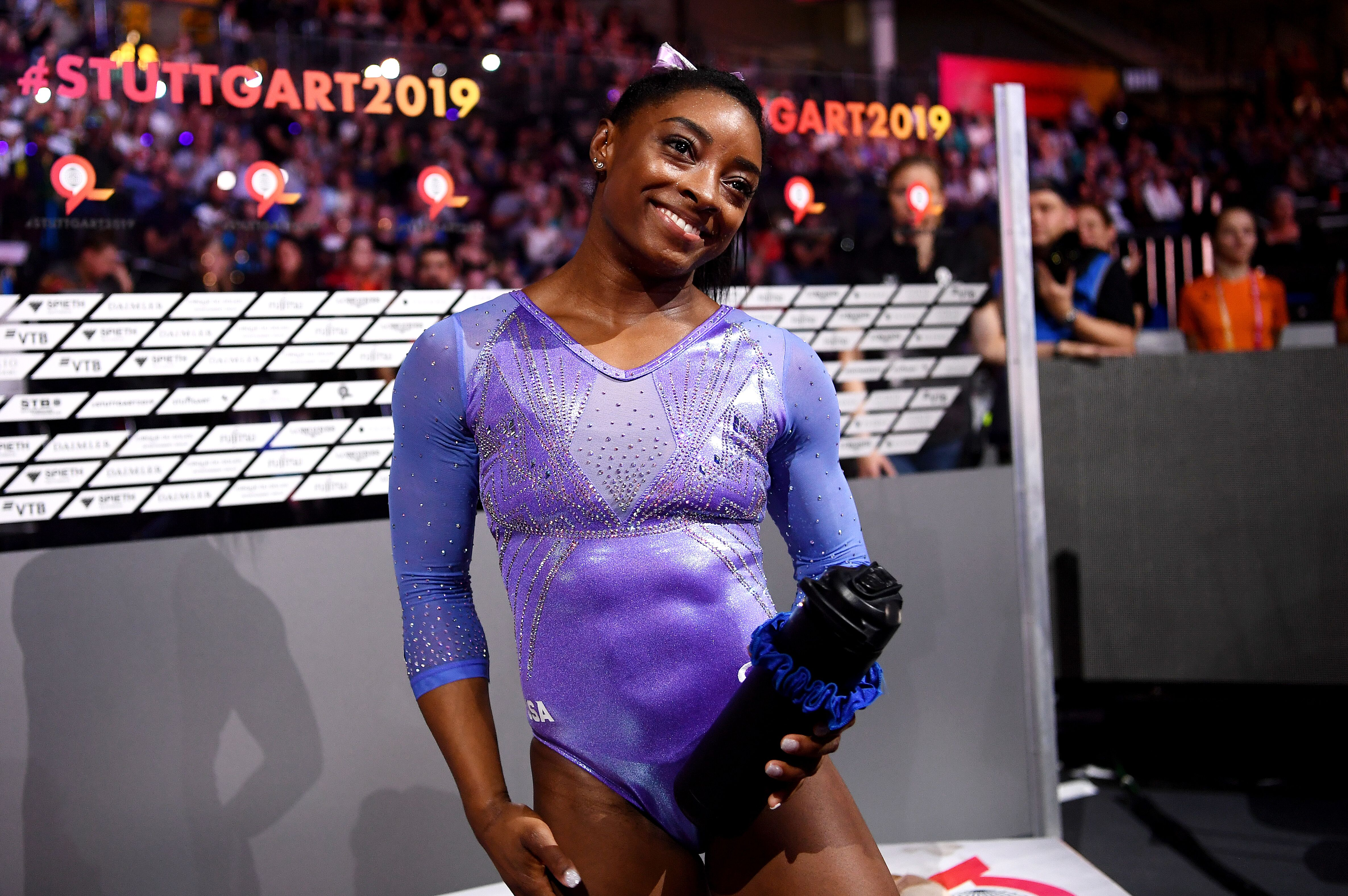 Simone Biles of The United States celebrates winning gold in Women's Floor Final during day 10 of the 49th FIG Artistic Gymnastics World Championships at Hanns-Martin-Schleyer-Halle on October 13, 2019 in Stuttgart, Germany.   Source: Getty Images