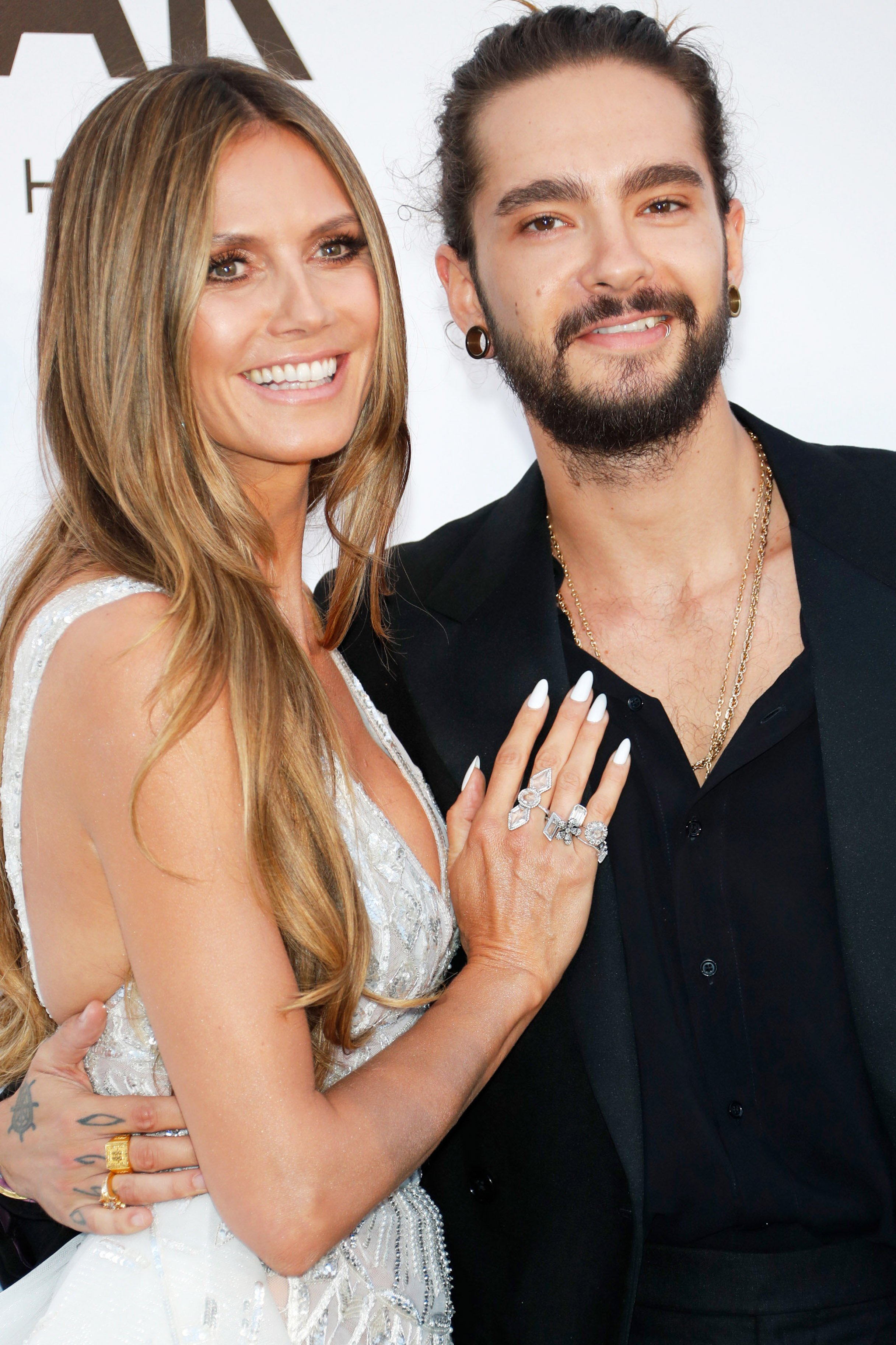 Heidi Klum (L) and Tom Kaulitz arrive at the amfAR Gala Cannes 2018 at Hotel du Cap-Eden-Roc on May 17, 2018, in Cap d'Antibes, France. | Source: Getty Images.
