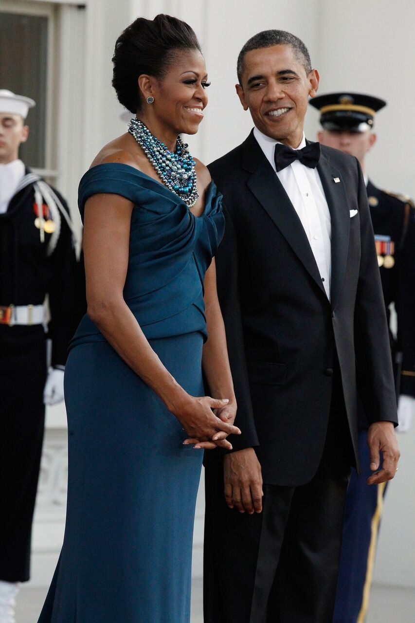 Barack & Michelle Obama await the arrival of British Prime Minister David Cameron and his wife Samantha at the White House.   Source: Getty Images