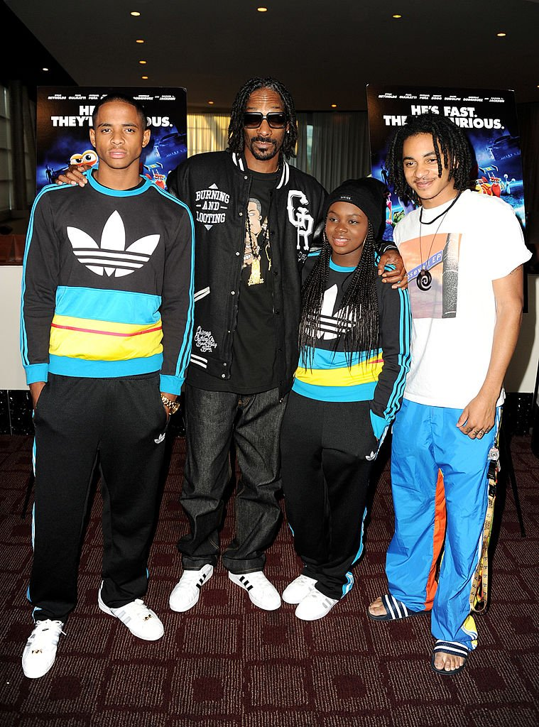 "Cordell Broadus, Snoop Dogg, Cori Broadus and Corde Broadus arrive at a special screening of DreamWorks Animation ""TURBO"" for the Snoop Youth Football League at the Arclight Theatre on July 16, 2013 