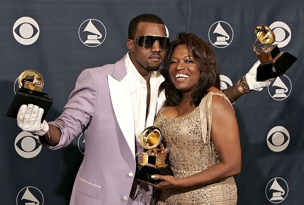 Kanye West with his awards for Best Rap Song, Best Rap Solo Performance and Best Rap Album with his mother Donda West at the 48th Annual Grammy Awards at the Staples Center on February 8, 2006, in Los Angeles, California. | Source: Getty Images.