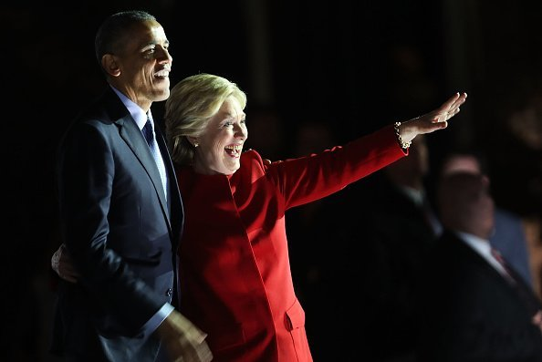 Democratic presidential nominee former Secretary of State Hillary Clinton with Barack Obama at an election eve rally on November 7, 2016 in Philadelphia, Pennsylvania. | Source: Getty Images