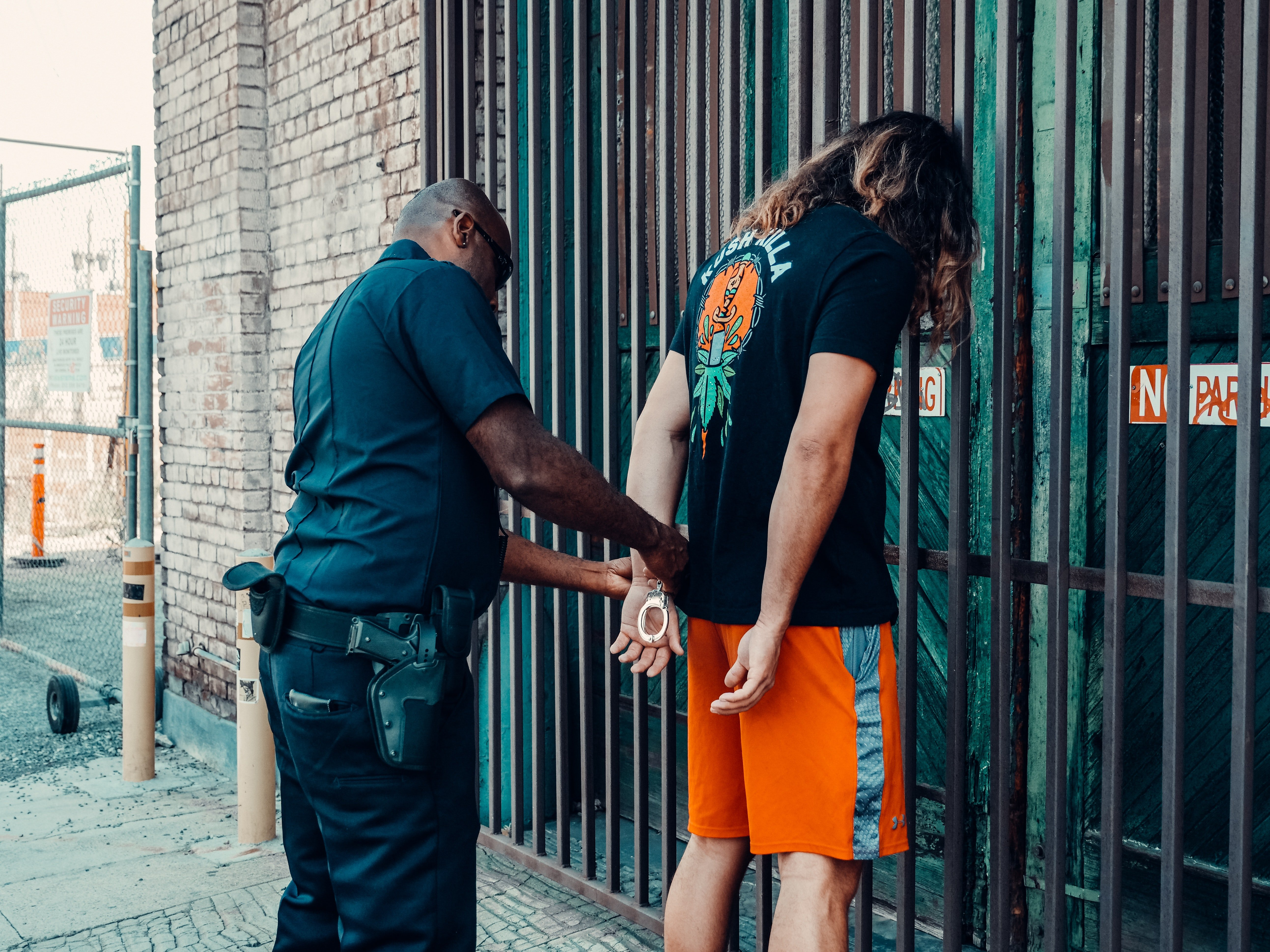 Pictured - A police officer apprehending a suspect   Source: Pexels