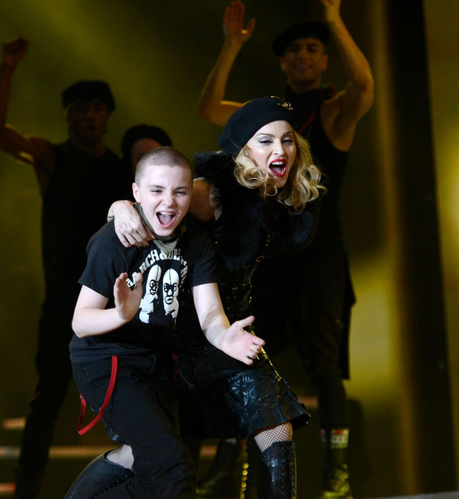 """Rocco Ritchie and Madonna on stage during her """"MDNA"""" tour in 2012 in Tel Aviv, Israel 