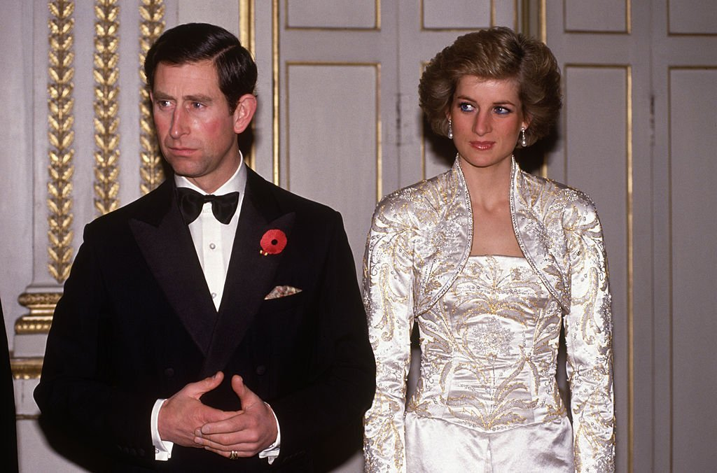 Prince Charles and Diana Princess of Wales meet guests arriving at a dinner in the Elysee Palace in Paris, France in November 1988, during the Royal Tour of France. | Source: Getty Images.