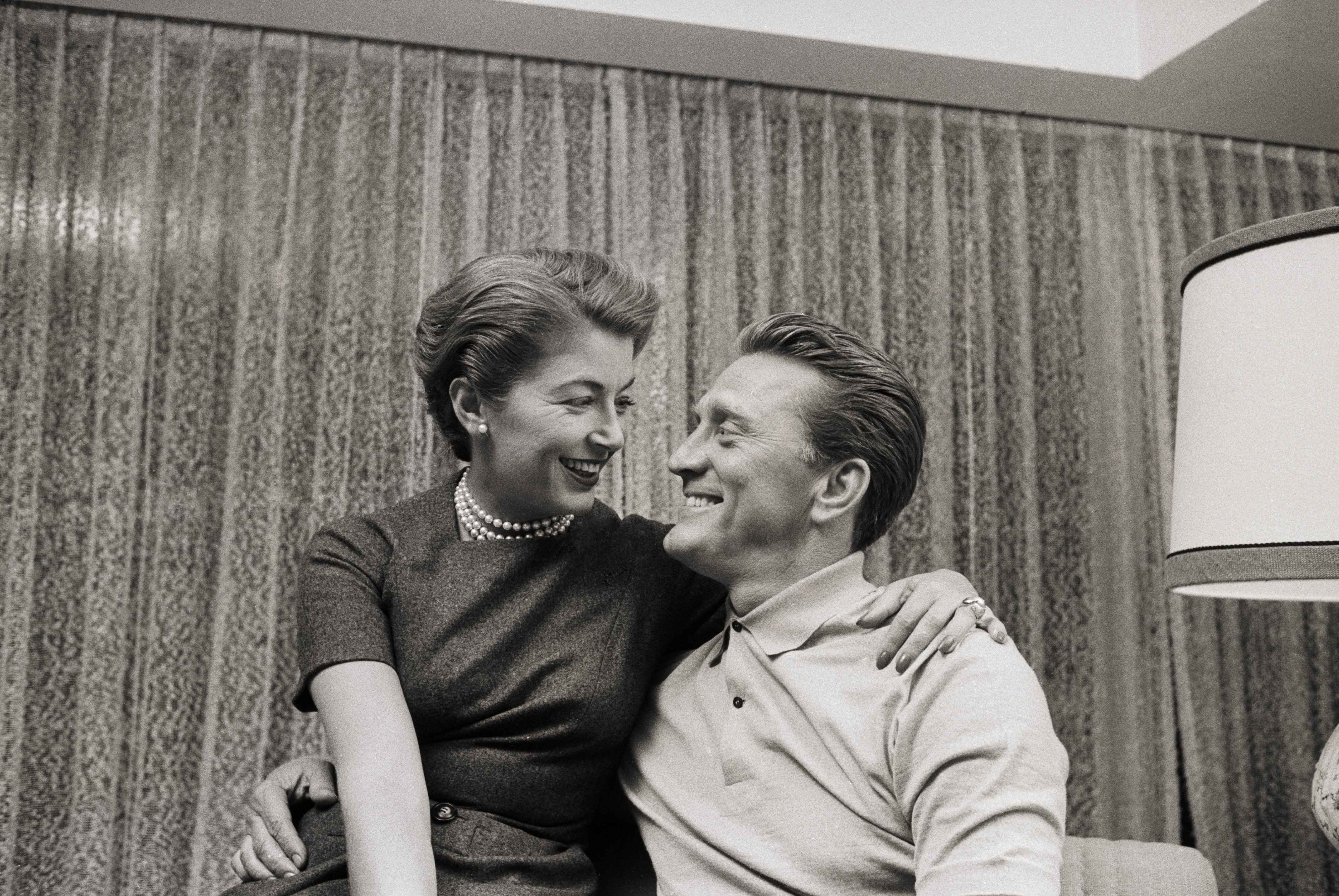Kirk Douglas and his spouse Anne Douglas gaze at each other while smiling following his nomination for an Academy Award on February 18 | Photo: Getty Images