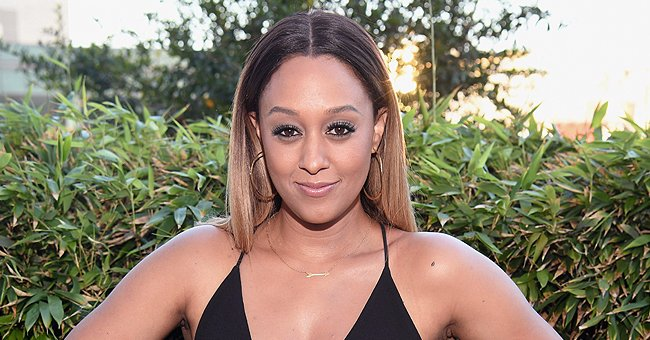 Tia Mowry Shares a New Photo of Her Daughter Cairo Wearing a Face Mask & Denim Overalls