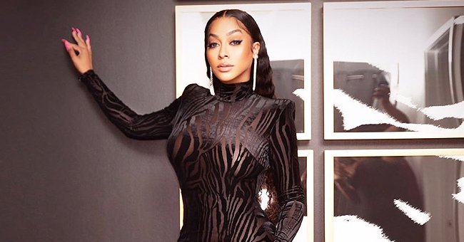 La La Anthony Looks Unforgettable Posing in a Tight Black Animal-Print Dress & High Heel Shoes