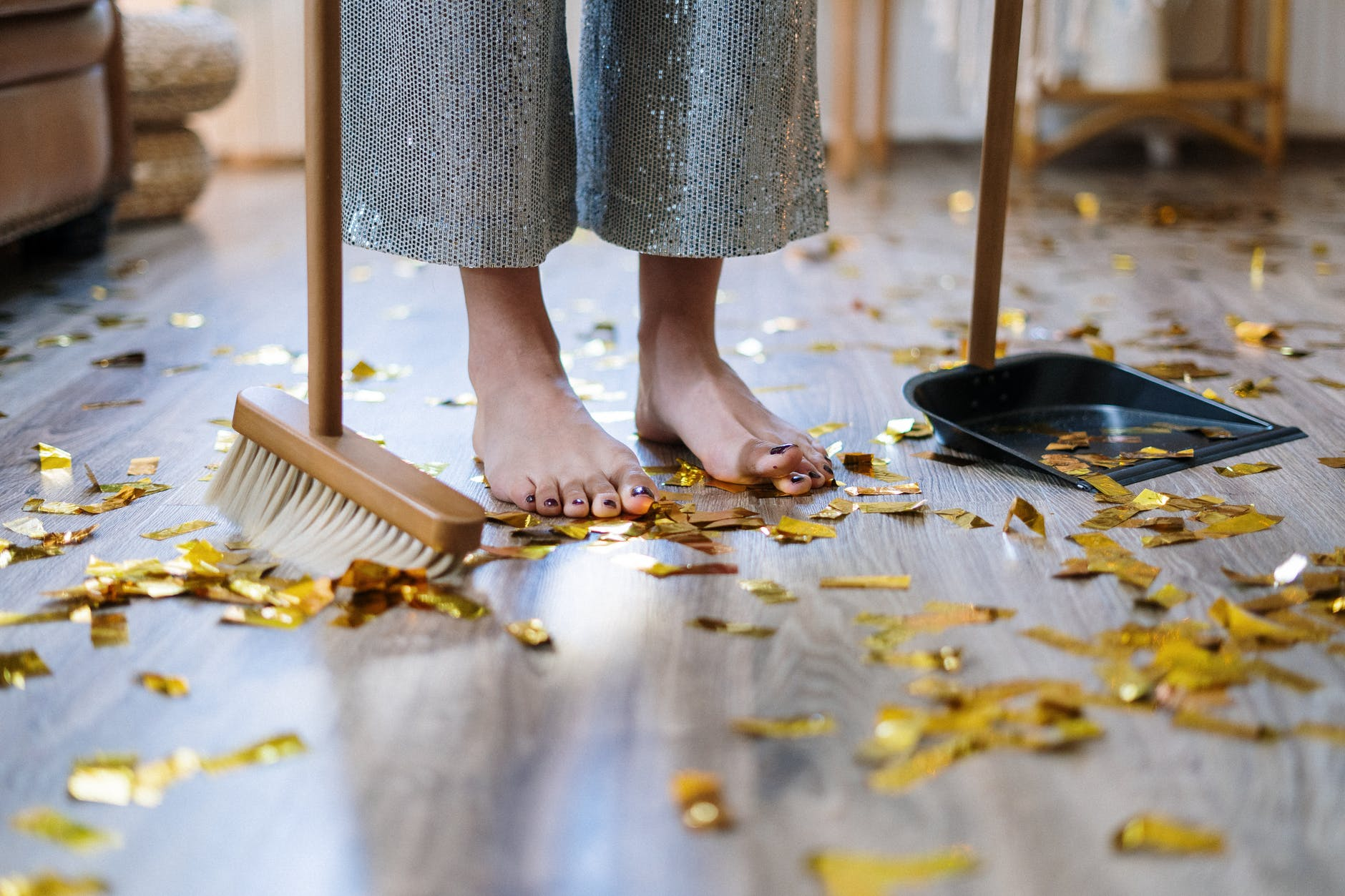 Woman sweeping confetti   Source: Pexels