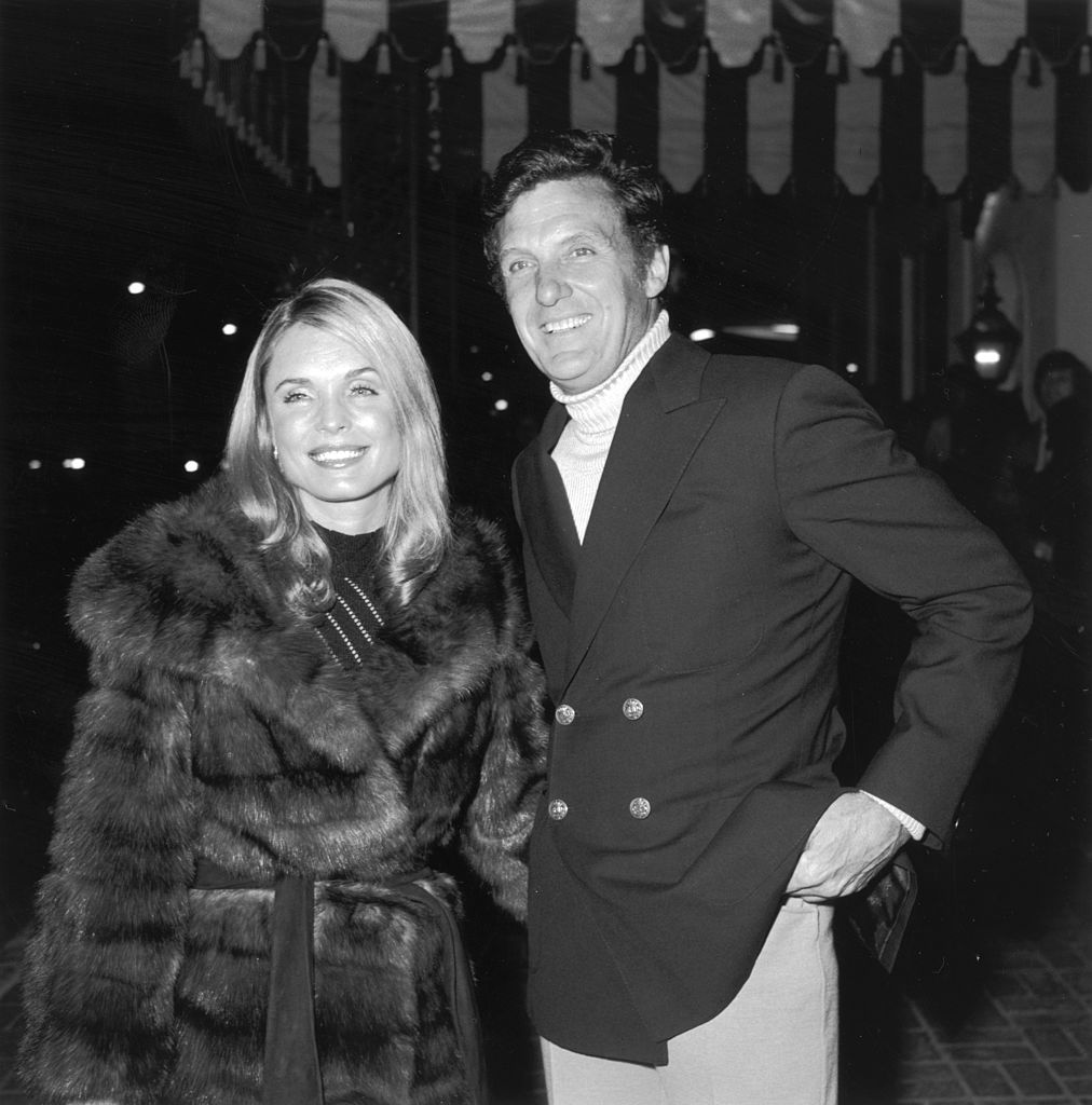 Married actors Robert Stack (1919 - 2003) and Rosemarie Bowe at a party for French skier and actor Jean-Claude Killy at Chasen's restaurant, Los Angeles in February 1972 | Photo: Getty Images