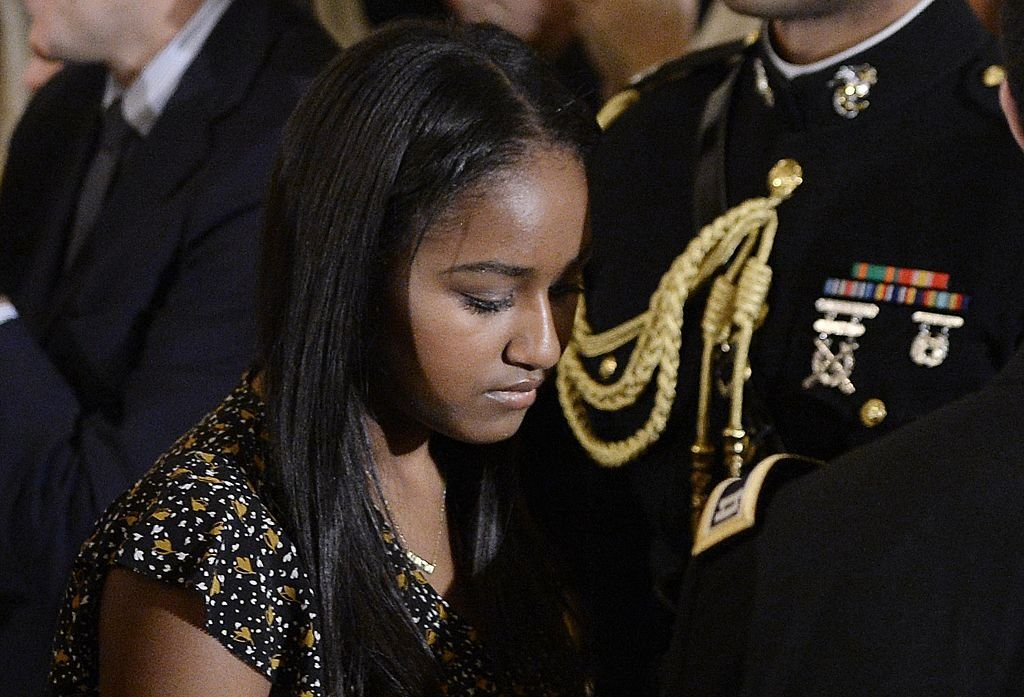 Sasha Obama leaves the State Dining room of the White House in Washington | Photo: Getty Images