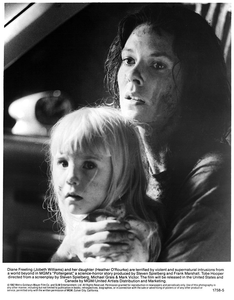"""Heather O'Rourkeheld by JoBeth Williams in a scene from """"Poltergeist""""