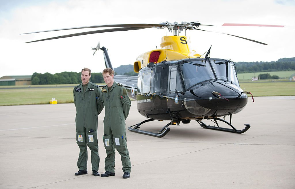 Prince William and Prince Harry attend a photocall during their training at Raf Shawbury, Nr Shrewsbury | Photo: Getty Images