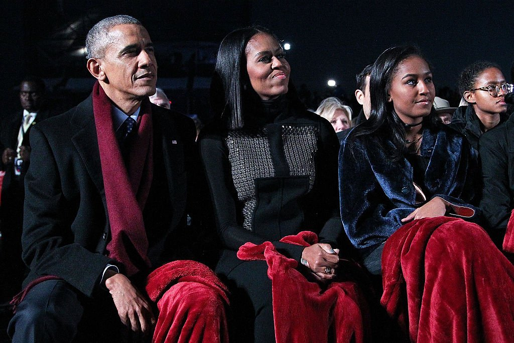 President Barack Obama sits with first lady Michelle Obama and their daughter Sasha to watch musical perfomances during the 94th Annual National Christmas Tree Lighting Ceremony on the Ellipse in PresidentÕs Park | Photo: Getty Images