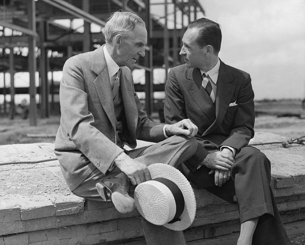 American motor manufacturer Henry Ford with his son Edsel, circa 1940 | Photo: Getty Images