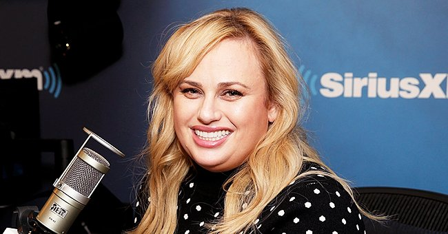 Rebel Wilson Looks Slim & Gorgeous as She Teases about Big News Wearing an Elegant Blue Dress
