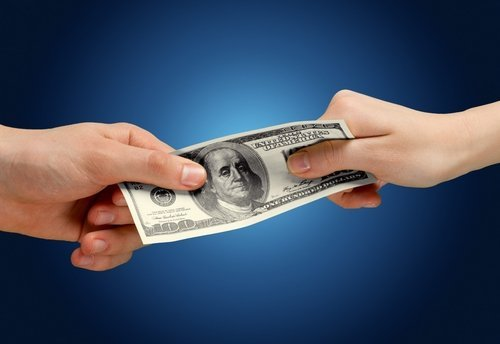 Concept of fighting over money. | Photo: Shutterstock.