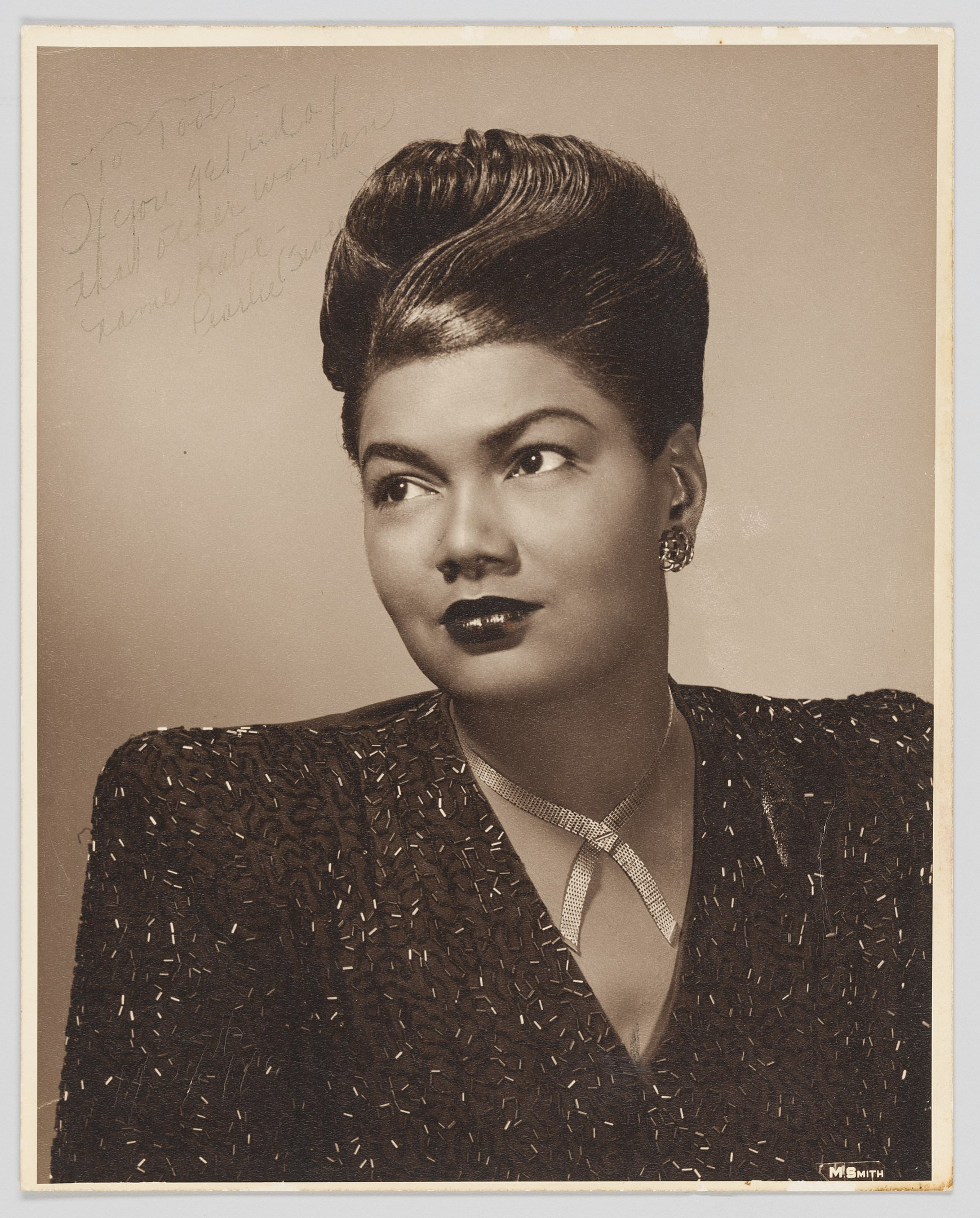 A black and white photo of Pearl Bailey taken in 1960 with an autograph of the actress | Photo, Wikimedia Commons Images, By Marvin Smith CC0