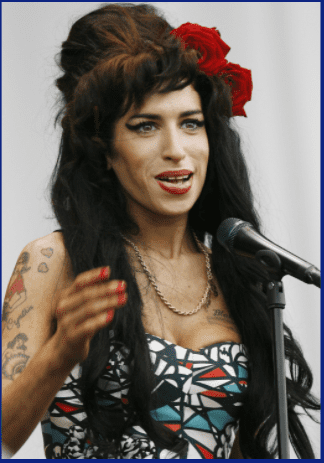 Amy Winehouse performs live on the V stage during Day Two of V Festival 2008 at Hylands Park on August 17, 2008 in Chelmsford, England | Source: Getty Images