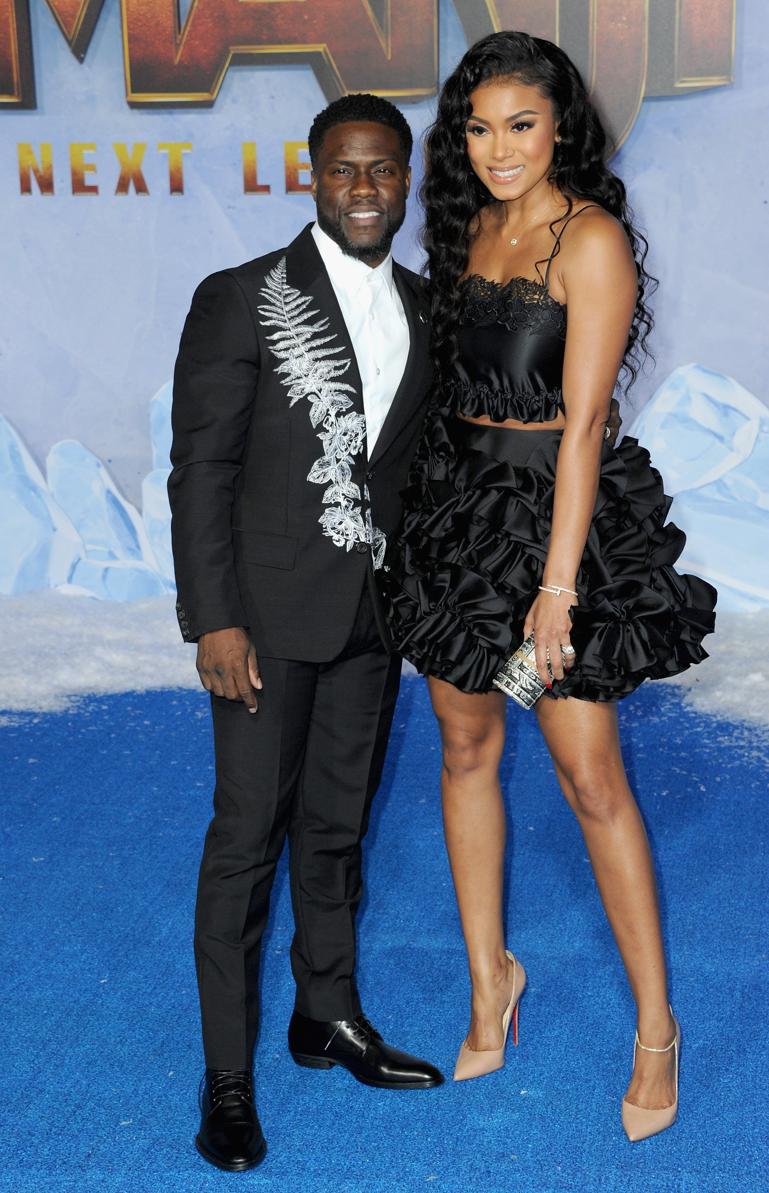 "Kevin Hart and wife Eniko Parrish arrive at the Premiere of ""Jumanji: The Next Level""  on December 9, 2019, in Hollywood, California. 