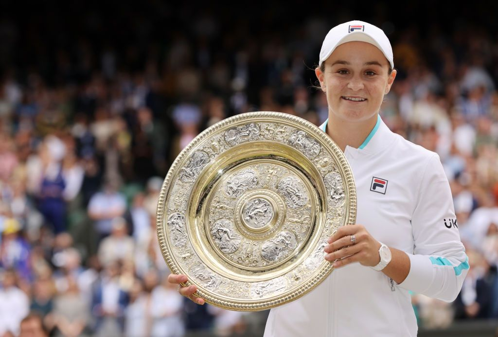 Australian tennis player Ash Barty holding the Venus Rosewater Dish trophy after winning her Wimbledon 2021 Ladies' Singles Final match against Karolina Pliskova at in London, England | Photo: Clive Brunskill/Getty Images