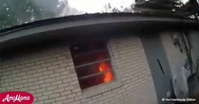 Woman can thank her lucky stars for being saved from a house fire in dramatic bodycam video