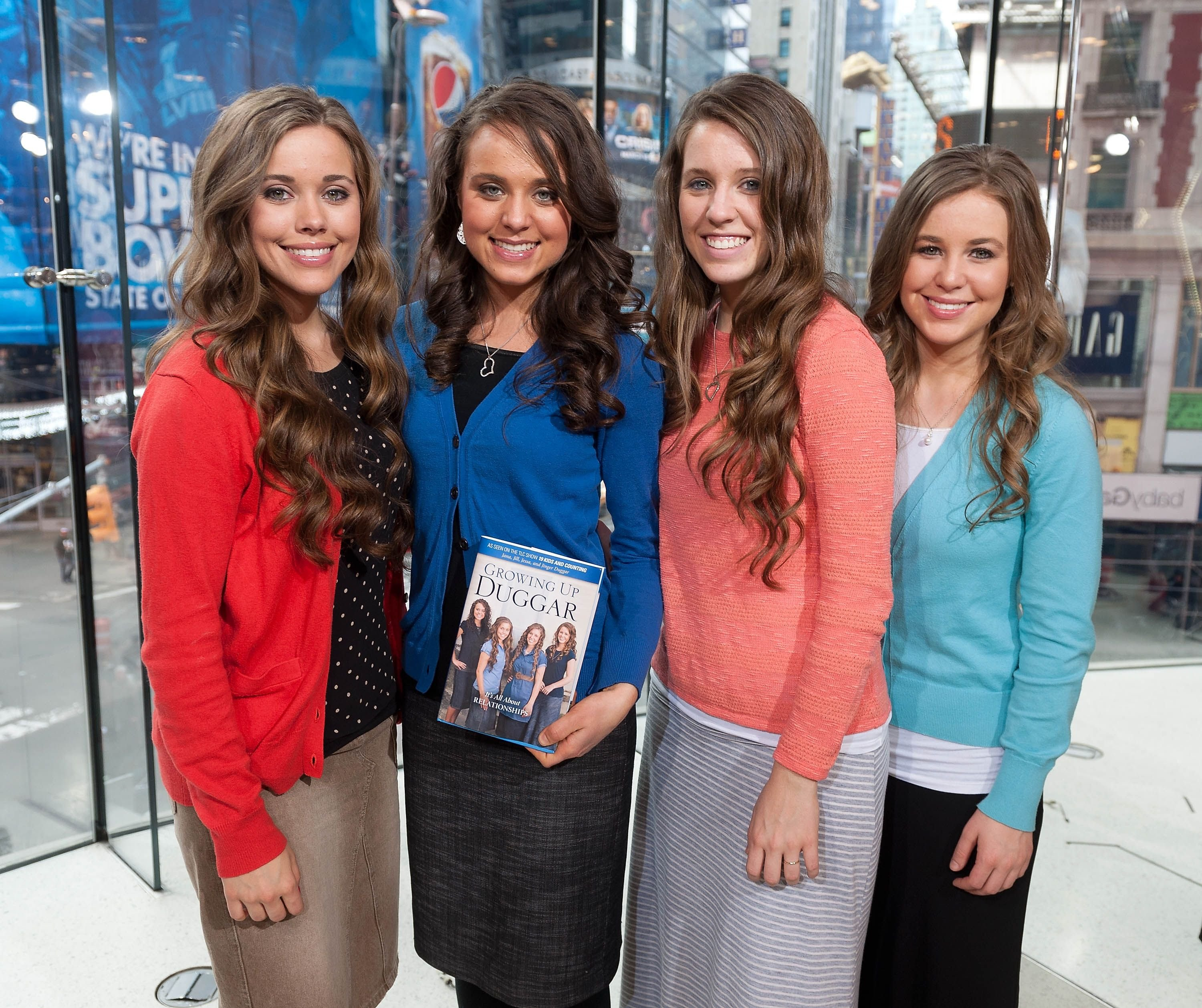 """Jessa, Jinger, Jill, and Jana Duggar visit """"Extra"""" at their New York studios at H&M in Times Square on March 11, 2014, in New York City 