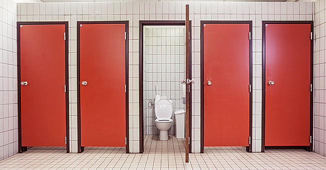 Daily Joke: A Man Hears Someone Talking to Him in the Restroom
