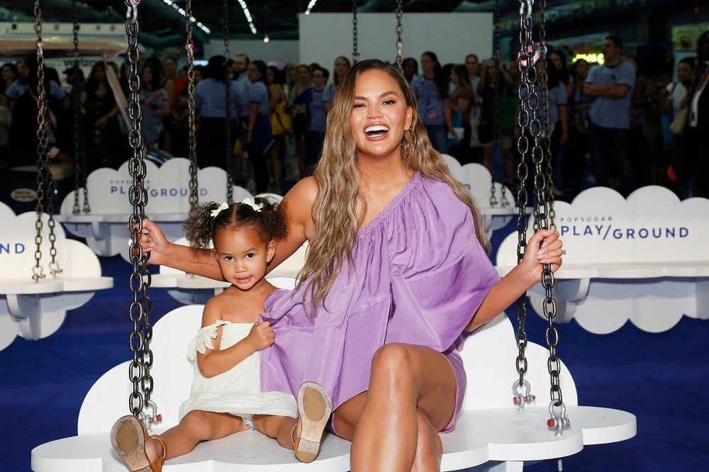 Luna Legend and Chrissy Teigen posing for a photo at POPSUGAR's Play/Ground at Pier 94 in New York City on June 2019. I image: Getty Images.
