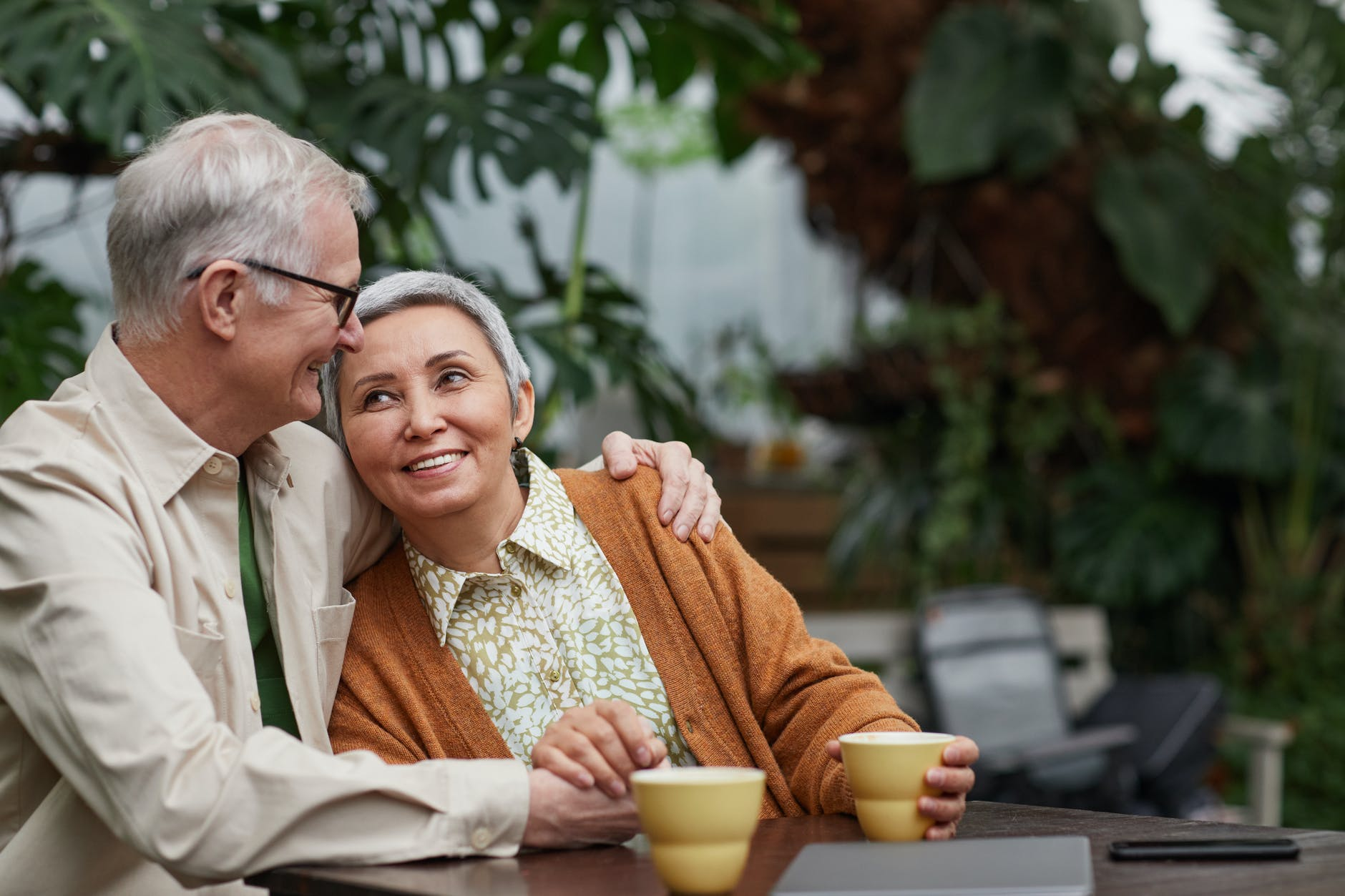 A smiling man with his arm wrapped around a smiling woman   Source: Pexels