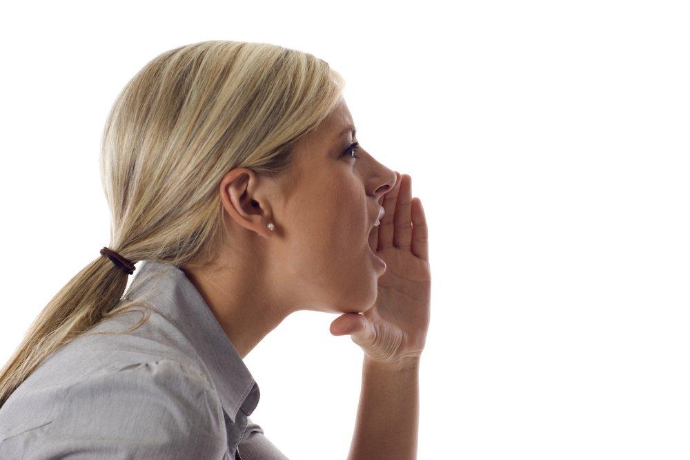 A woman shouting.| Photo: Shutterstock.