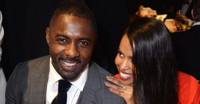 Idris Elba's Wife Sabrina Flaunts Her Curvaceous Body in a Black Dress with a Plunging Neckline