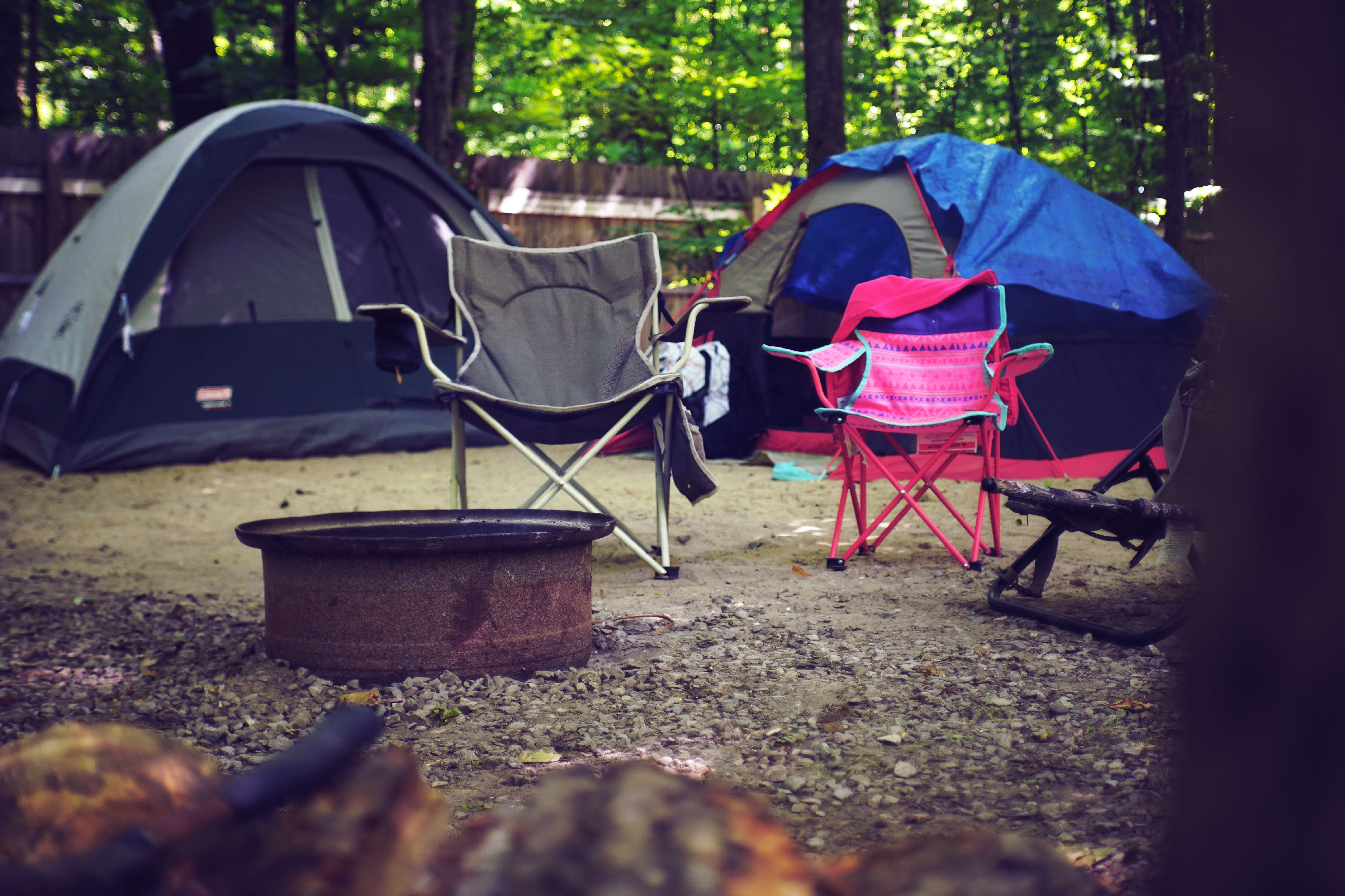 Pictured - Camping chairs and tents   Source: Pexels
