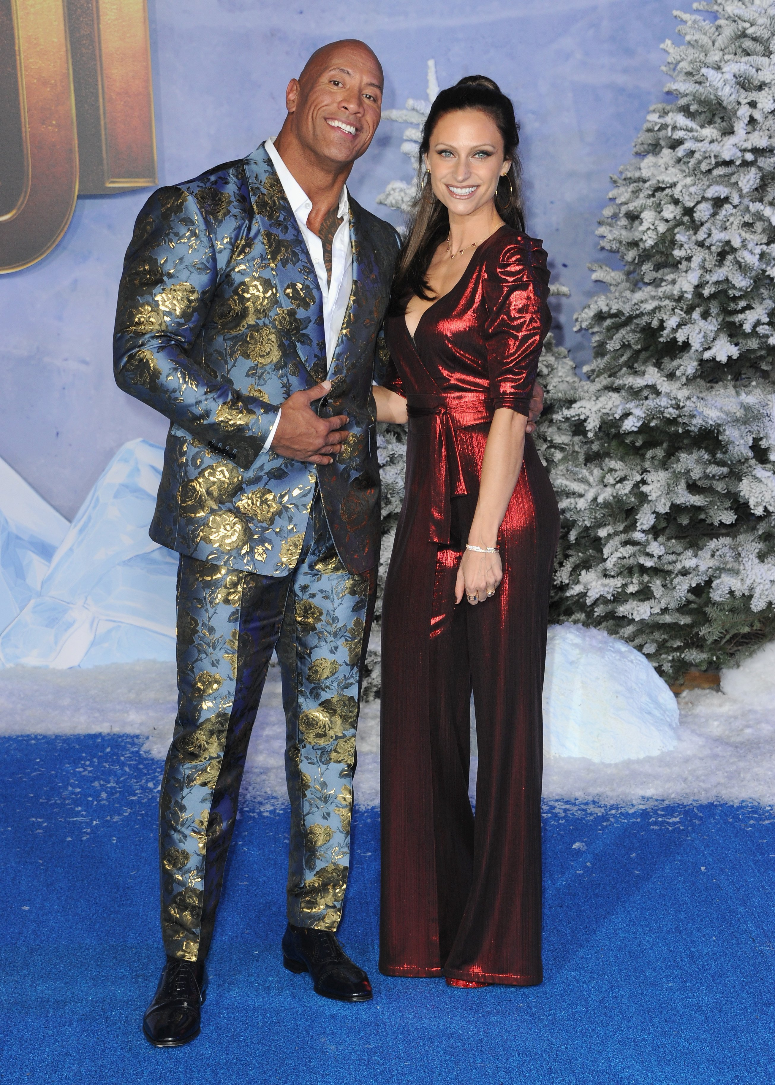 "Dwayne Johnson and wife Lauren Hashian arrive at the Premiere Of Sony Pictures' ""Jumanji: The Next Level"" held at TCL Chinese Theatre on December 9, 2019, in Hollywood, California. 