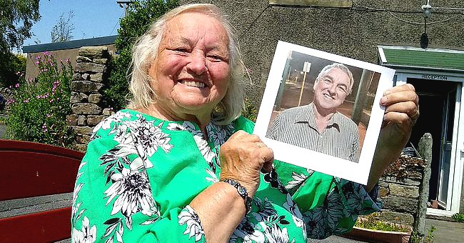 Issy Carr smiles with a photo of her long lost son.   Source: twitter.com/DailyMirror