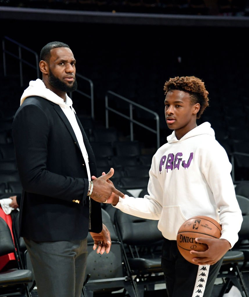 LeBron James #23 of the Los Angeles Lakers and his son LeBron James Jr., on the court after the Los Angeles Clippers and Los Angeles Lakers basketball game  | Getty Images / Global Images Ukraine