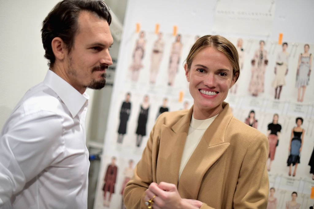 Kristopher Brock and Laura Vassar prepare backstage for Brock Collection during New York Fashion Week: The Shows at Gallery II at Spring Studios on February 9, 2018. | Photo: Getty Images