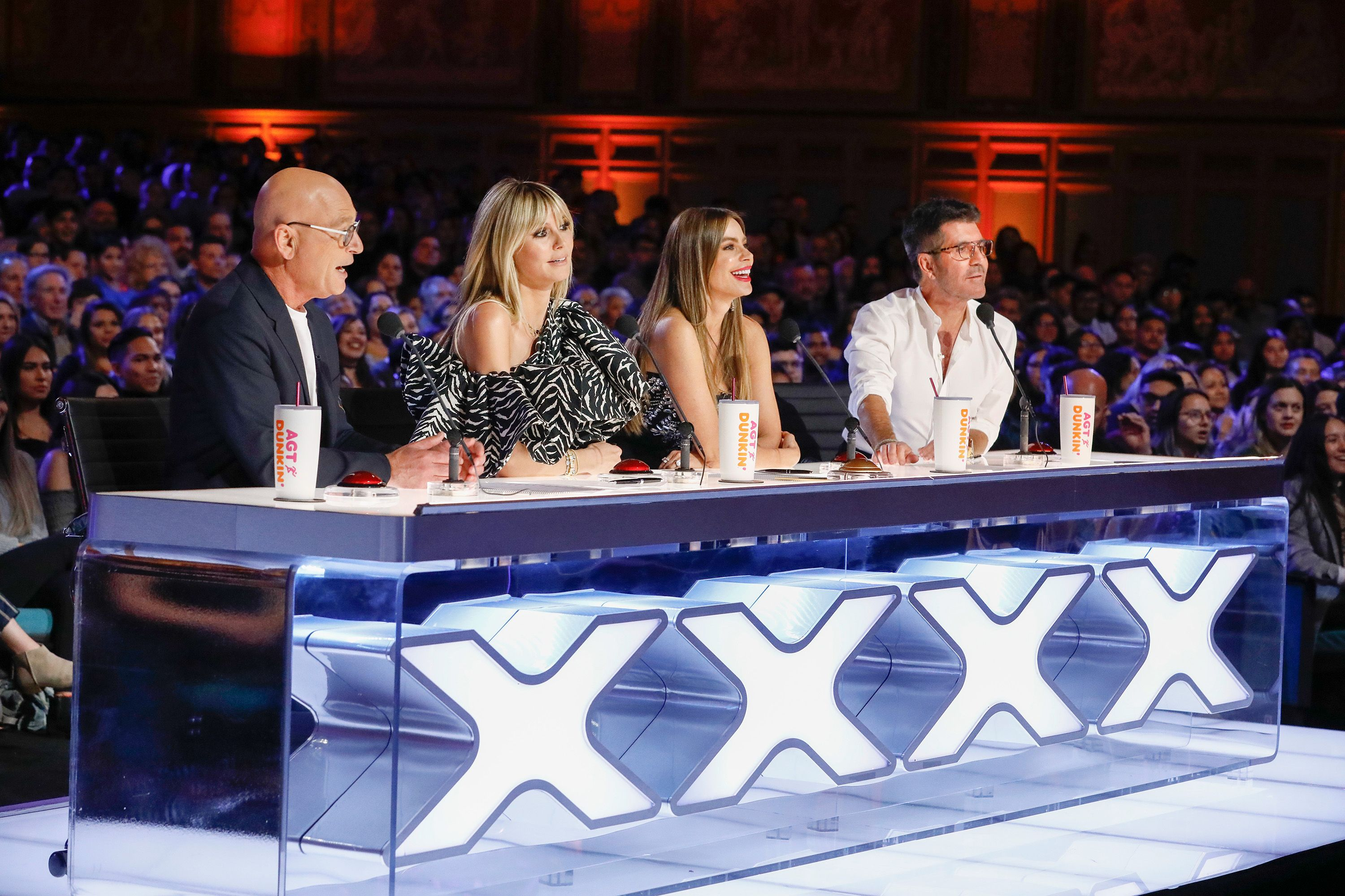"""The judges of """"AGT"""" Howie Mandel, Heidi Klum, Sofia Vergara, and Simon Cowell captured during an audition on March 02, 2020"""