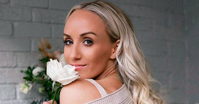 Nastia Liukin Turns up the Heat in Floral Swimsuit on a Sandy Beach in TBT Photo