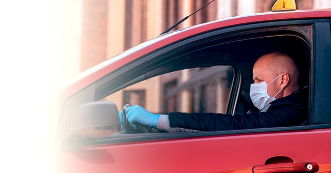 A cab driver sitting in the front seat. | Source: Shutterstock