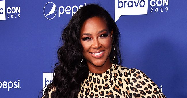 Kenya Moore's Look-Alike Daughter Brooklyn Enjoys Playing with Fountains in Bright Pink Swimwear