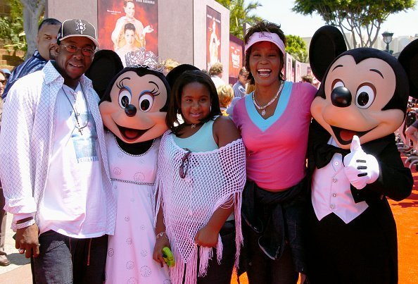Whitney Houston, Bobby Brown, and Bobbi Kristina at the Disneyland Resort August 7, 2004 in Anaheim, California | Photo: Getty Images
