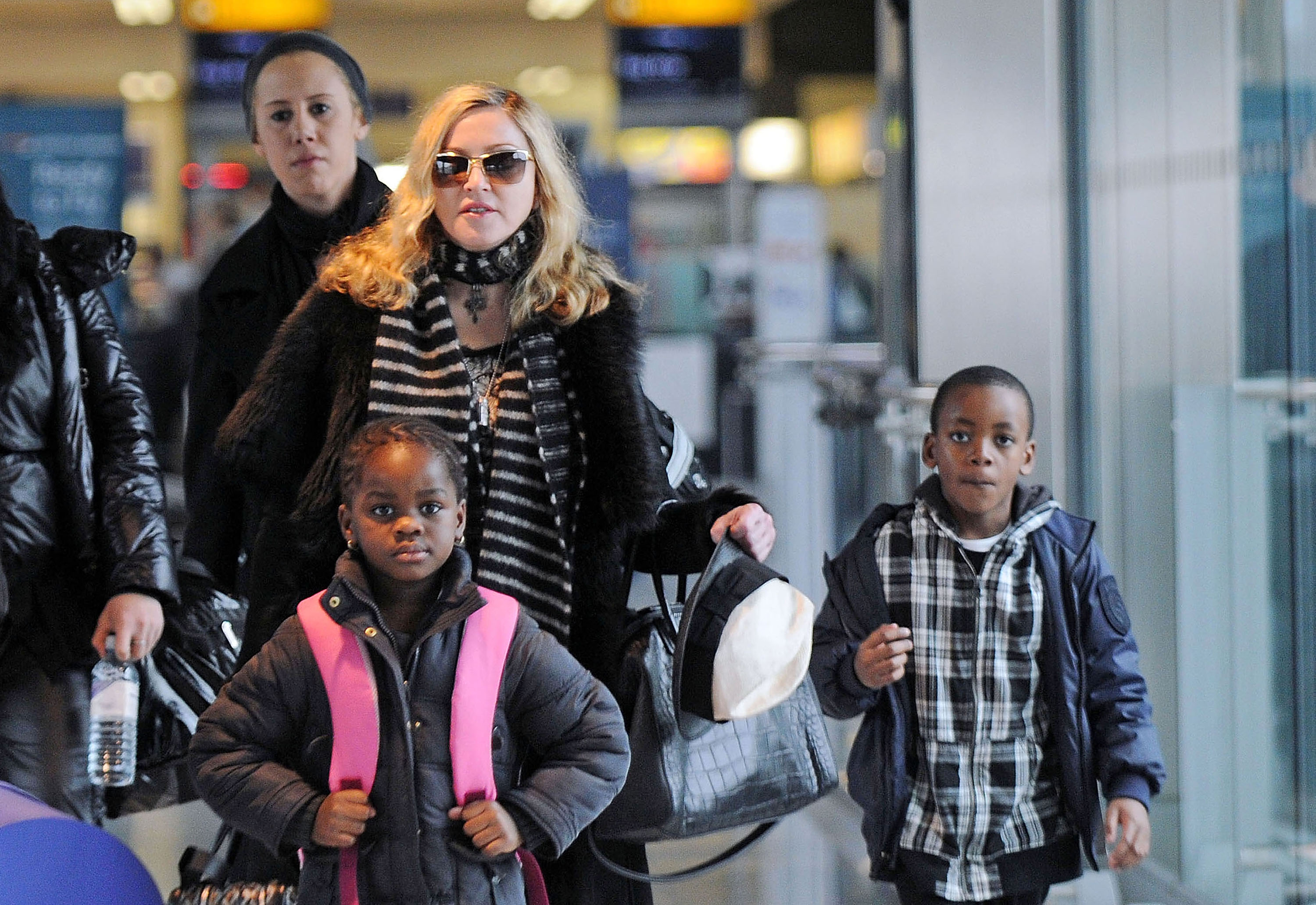 Madonna walks with son David and daughter Mercy in London, UK on April 2, 2011 | Photo: Getty Images